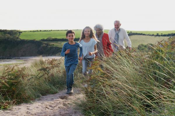 Family walking in sand dunes